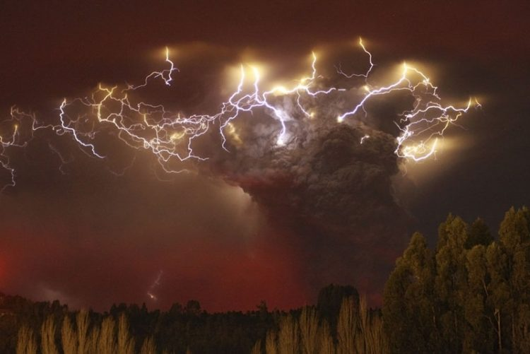 Lightning flashes around the ash plume at above the Puyehue-Cordon Caulle volcano chain near Entrelagos June 5, 2011. The volcano in the Puyehue-Cordon Caulle chain, dormant for decades, erupted in south-central Chile on Saturday, belching ash over 6 miles (10 km) into the sky, as winds fanned it toward neighboring Argentina, and prompted the government to evacuate several thousand residents, authorities said. Picture taken June 5. REUTERS/Carlos Gutierrez (CHILE - Tags: ENVIRONMENT DISASTER IMAGES OF THE DAY)